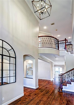 Stunning entry with soaring ceilings and gleaming white oak hardwood flooring. Per seller, new entry chandelier installed September 2017. (photo 3)
