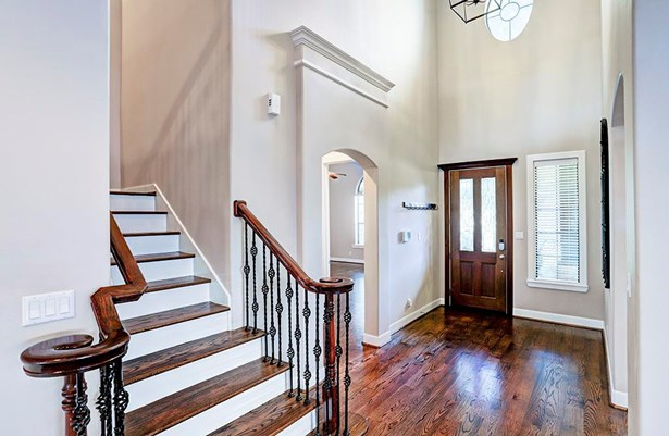 Another view of the bright entry. Per seller, the wood flooring was just redone in September of 2017. (photo 4)