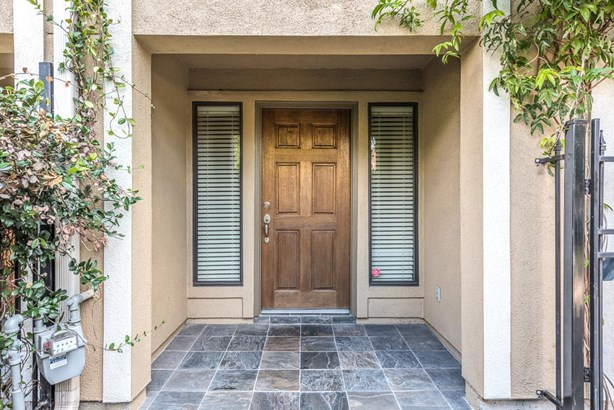 Private and gated front entrance with slate flooring welcomes your arriving guests. (photo 2)