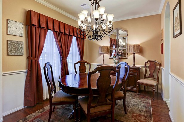 Gleaming hardwoods and an elegant chandelier add so much to this lovely dining room. (photo 3)