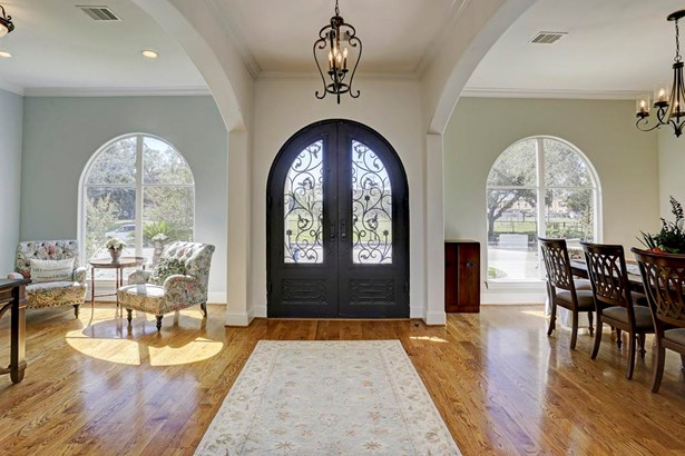 Elegant front entry to the home invites you inside and is warmed with natural light. (photo 4)