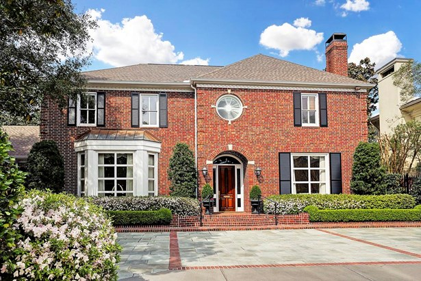Another photo of exterior front, a classic red brick Georgian, 1990 construction. 6,142 square feet per HCAD, immaculate condition. Broad Oaks Trail is a cul de sac location with 6 homes. (photo 5)