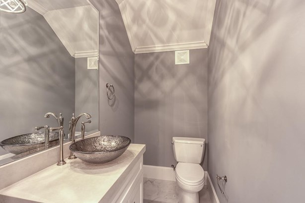 Landing foyer with adjacent downstairs powder room. (photo 5)