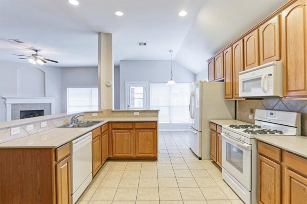 Spacious open kitchen over looks the Breakfast Room and Living Room. (Refrigerator included) (photo 4)
