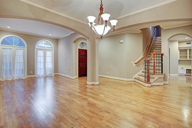View of dining room and formal living room. (photo 3)