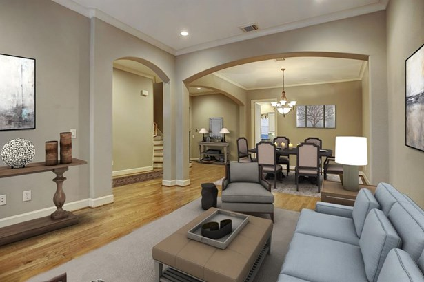 Virtually staged photo of the formal living and dining room. (photo 5)