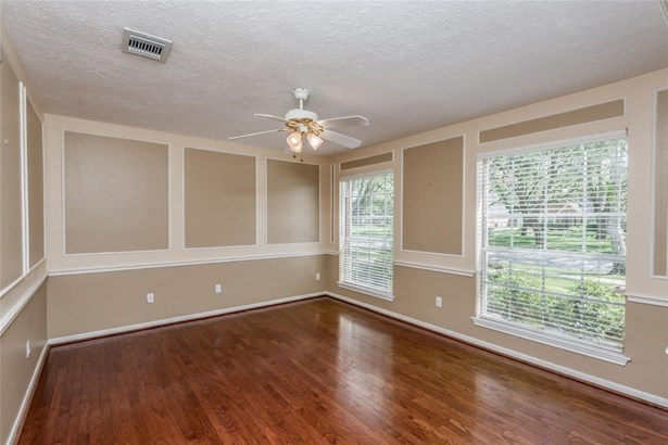This is the formal dining room with beautiful wood floors and wall molding accents for added interest. This dining room is located just off the entry and just around the corner from the kitchen area. (photo 5)