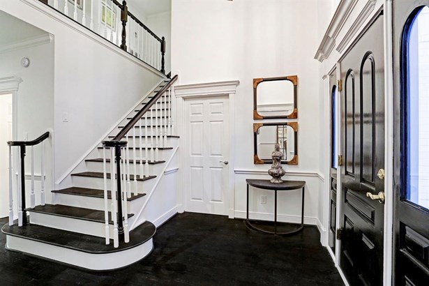 The entry features a two story ceiling and views into the entire first floor and backyard. (photo 3)