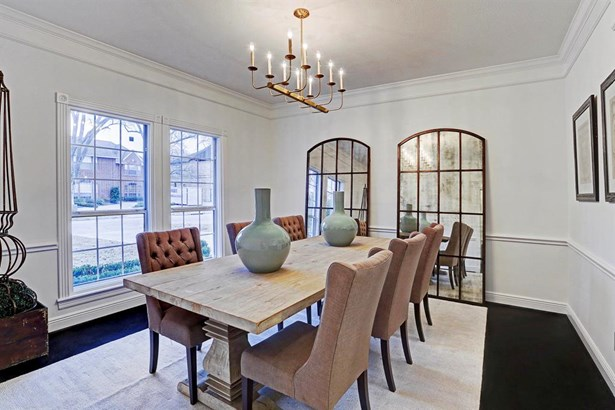 The formal dining room offers stunning views of the front yard and brings in tons of natural lighting. This room is spacious and perfect for entertaining all of your guests. (photo 5)