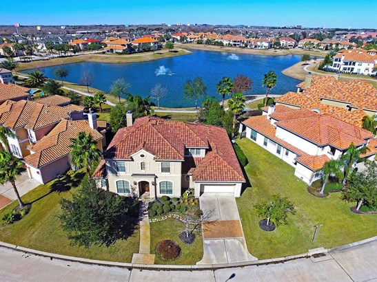14302 Shadow Garden Ln sits on a 10,290 SF lakeview lot. There is a walking trail around the lake and $2M homes across the way. (photo 1)