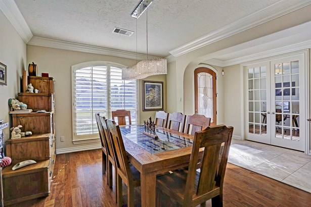 The formal dining room and study with French doors straddle the entry foyer. (photo 5)