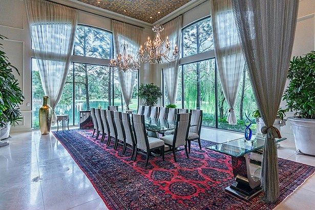 Host a large group of friends and family for luncheon or dinner in the FORMAL DINING area with massive window views of the grounds and lake. A large fully equipped private Caterer s Kitchen is concealed just steps away. (photo 5)