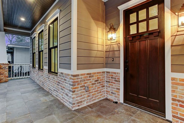 Charming front porch is surrounded by white railing. (photo 5)