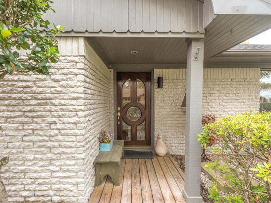The wood deck provides a fresh approach to the covered front entrance and wood & glass front door.. (photo 3)