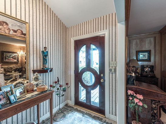 Light filled marble tile entry welcomes you and opens to the formal living room just to the right. (photo 4)