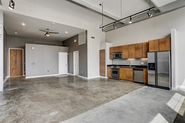 A blend of contemporary and industrial features give character and simplicity to an urban loft theme with exposed duct work, pipes, brick, stainless steel, and raw hardwood and concrete floors. (photo 1)