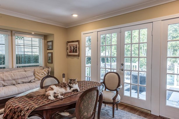 Wonderful place to enjoy the morning or just relax with guests. The French doors open to the outdoor entertaining deck and pool area. (photo 5)