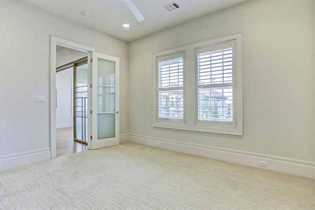 Upstairs secondary guest bedroom contains plantation shutters, high ceilings and radiates a pleasant ambiance. (photo 3)