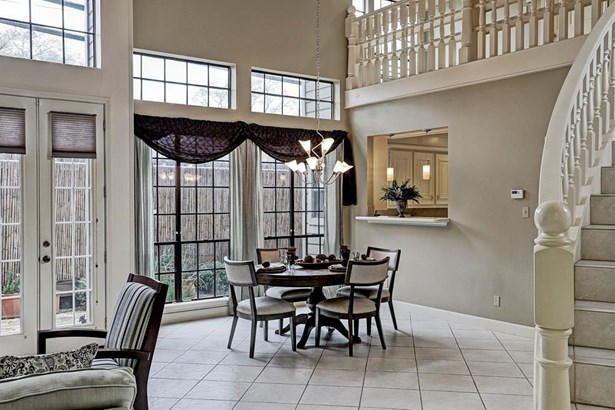 Dining Room with loft/study overlooking and French doors leading out to the private garden/patio. (photo 4)