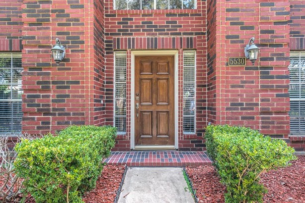 Lovely all-brick front entrance with wood front door and welcoming side lanterns. (photo 2)