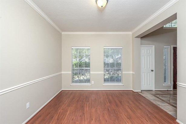 The formal study has double French door entry, contrasting built-in sheving & crown molding and 2 large windows overlooking the front lawn. (photo 5)