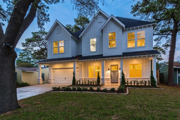 Another view of this gorgeous facade featuring lush landscaping and mature trees, along with meticulous details including bead board paneling on the the porch ceiling, designer light fixtures and slurried brick border. (photo 2)