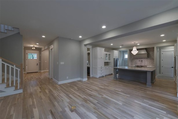 Great flow from the family room into the kitchen and all the way to the front of the house. Soft paint colors and light hardwoods make this home peaceful and serene. (photo 5)