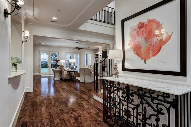 The wide entry hall provides views into the Formal Living, Formal Dining, Family Room and Wet Bar. Recessed and sconce lighting accent decorative ceiling detail. (photo 3)
