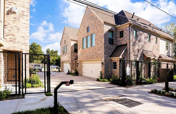 This Gated entry is easily accessible by guests through a pedestrian gate and for owners through the driveway gate with keypad. (photo 3)