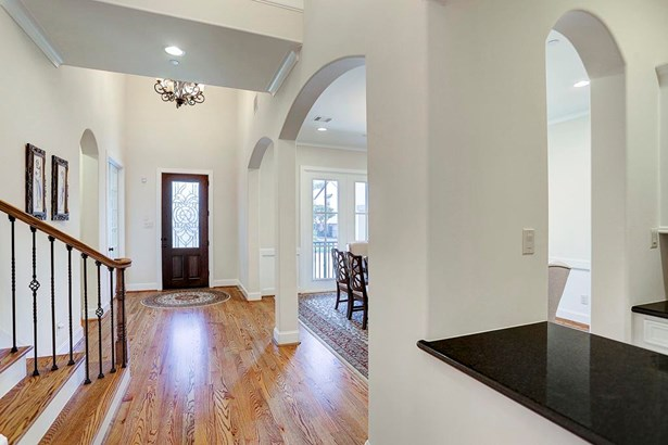 Beautiful 2 story Entry with hardwood floors, wide hallway, and spacious, bright atmosphere. (photo 2)