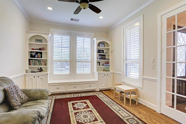 The first floor flex room could be the 5th Bedroom as there is a full bath and closet or a great study or play room and also features built-in storage, plantation shutters, and built-in window bench. (photo 3)