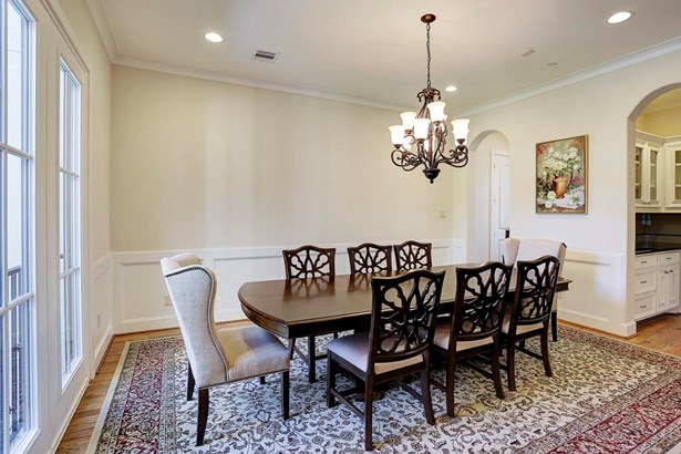 The Dining Room features hardwood floors, crown molding, wainscoting, butlers pantry, and great windows for good natural light. (photo 4)