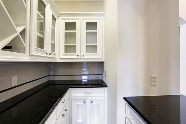 The Butler s Pantry offers a great space for entertaining and includes upper and lower cabinets, granite countertops, and wine storage. (photo 5)