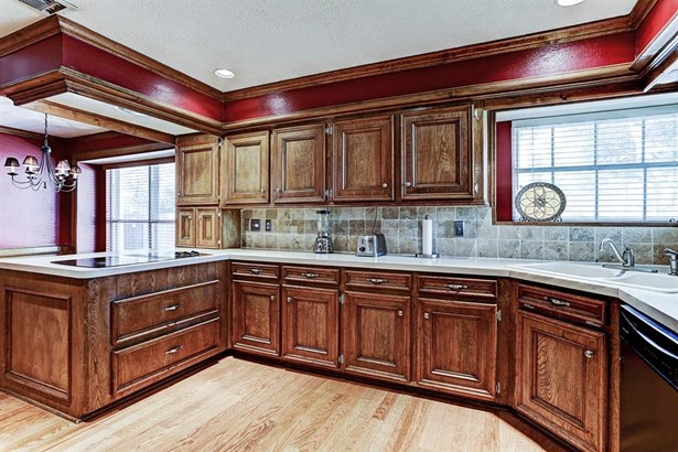 Alternative view of the kitchen with custom hardwood cabinetry. (photo 3)