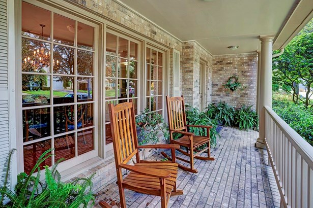 Covered front porch. A great place to sit and relax. (photo 2)