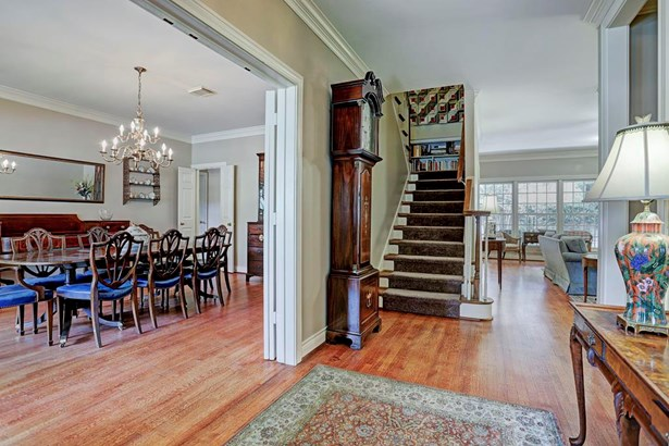Inside the large foyer, you can see the formal dining room to the left and beyond that is the family room. (photo 4)