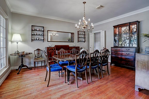 Formal dining - high ceilings, crown molding, chandelier. Room has ample space to accommodate a larger table. (photo 5)