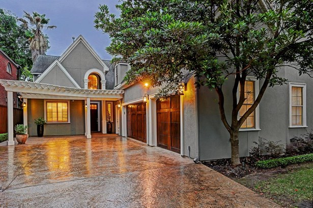 Gated home with upgraded solid wood three car garage doors with room for four additional guest vehicles within gated area (photo 1)