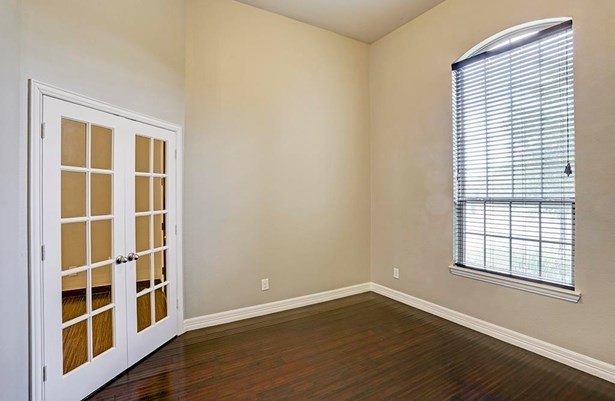 The study is so warm and welcoming with its gleaming hardwood floors and lovely French doors. (photo 2)