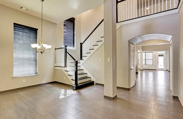 Gorgeous upscale tile flooring enhances this large dining room and open floor plan. (photo 4)