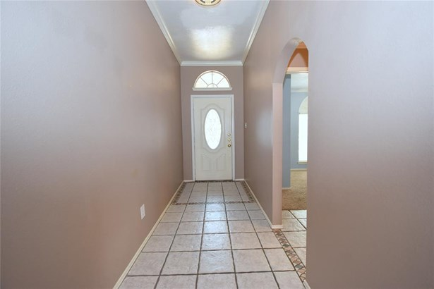 Wide entry with high ceiling and crown molding. The two secondary bedrooms are through the opening on the right. (photo 4)