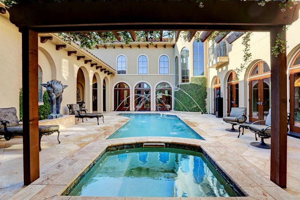 Exceptional custom Tuscan courtyard designed home overlooking the 12th fairway in the Estates section of ROCC. (photo 1)