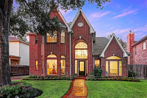 This beautiful red brick, traditional home has two new AC's (2014), new roof (2014), new paint throughout home, updated lighting fixtures, remodeled stairs and fireplace, wired house so all wireless in living room, game room and master bedroom as well as (photo 1)