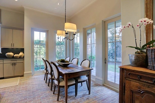 Closer view of breakfast room, patterned brick flooring. Beautiful windows and custom finishes! (photo 5)