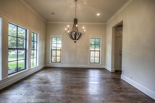 A long foyer is accented with shiplap paneling painted in a nice bright white. Through cased opening shown right is a large dining room featuring tall windows flooding the space with natural light. (photo 4)