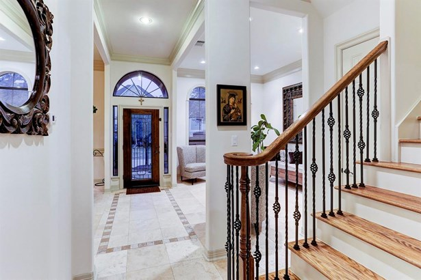 Beautiful Entry with natural stone floors, high ceilings, and plenty of natural light! (photo 2)