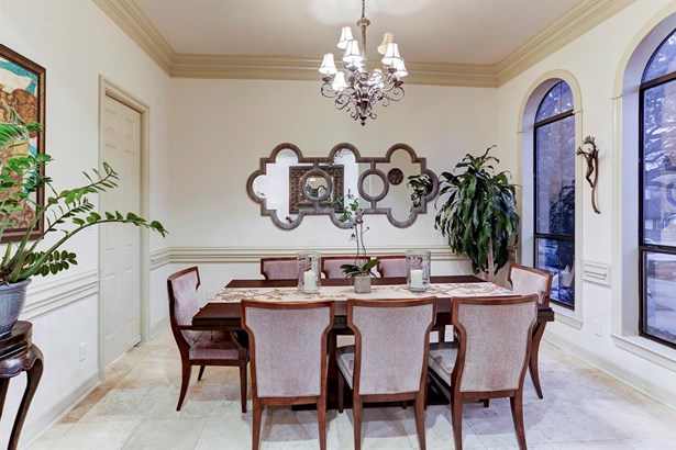 Formal Dining Room with 2 large windows, travertine floors, crown molding, and easy access to Kitchen. (photo 3)
