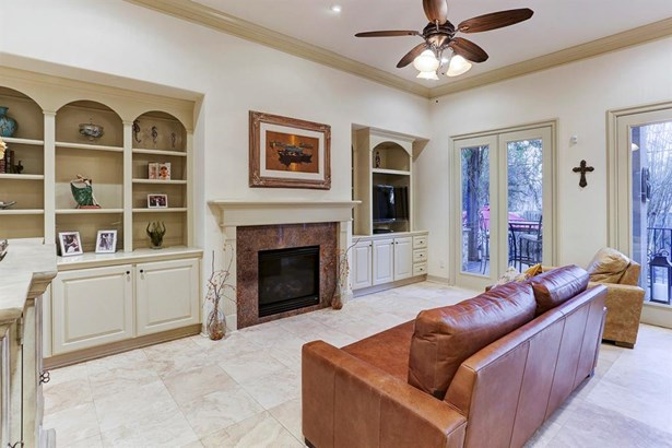 The Family Room gives you functional built-in storage, gas fireplace with granite surround, and a wall of windows facing the backyard and covered Patio. (photo 5)