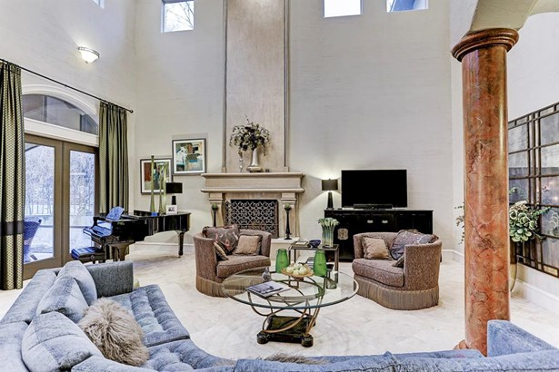The generous living room area has a wood burning fireplace with plumbed natural gas for easy fire starting. (photo 5)