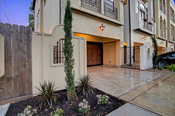 Through the wrought iron gate with lock is the paved walkway leading to the front door. Large corner lot boasts ample space for pets to roam. (photo 3)